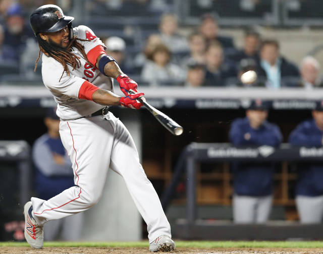 FILE - In this May 9, 2018, file photo, Boston Red Sox's Hanley Ramirez hits a seventh-inning, two-run home run off New York Yankees relief pitcher Chad Green in a baseball game in New York. Free agent slugger Hanley Ramirez has signed with the Indians, who hope he can give them some power. The 35-year-old Ramirez passed his physical and reported to training camp on Tuesday, Feb. 26, 2019. (AP Photo/Kathy Willens, File)