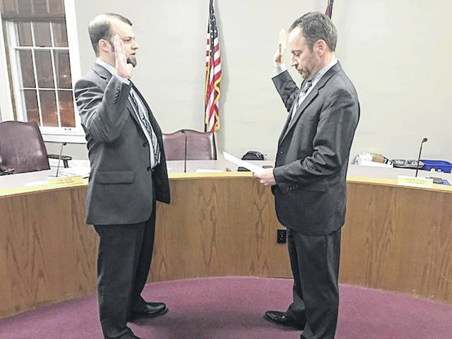 Damin Cappel is sworn as a Sunbury Village Councilman by David Brehm on Feb. 6.