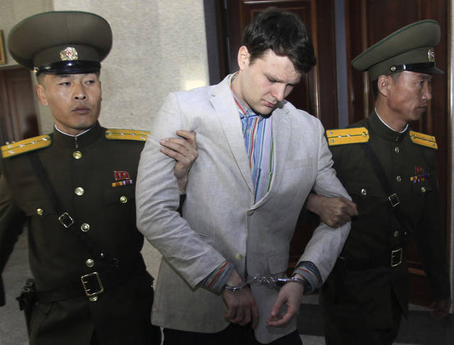 "FILE - In this March 16, 2016, file photo, American student Otto Warmbier, center, is escorted at the Supreme Court in Pyongyang, North Korea. President Donald Trump says he doesn't think North Korean leader Kim Jong Un was involved in the mistreatment of American college student Otto Warmbier, who died after being detained in the North. Trump says of Kim: ""He tells me that he didn't know about it, and I will take him at his word."" The Ohio native was sentenced to 15 years of hard labor in North Korea on suspicion of stealing a propaganda poster. Warmbier died in 2017, shortly after being sent home in a coma. (AP Photo/Jon Chol Jin, File)"