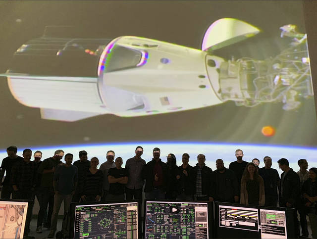 In this photo provided by SpaceX, the SpaceX team in Hawthorne, Calif., watches as the SpaceX Crew Dragon docks with the International Space Station's Harmony module, Sunday, March 3, 2019. SpaceX's new crew capsule arrived at the International Space Station on Sunday, acing its second milestone in just over a day.  (NASA via AP)
