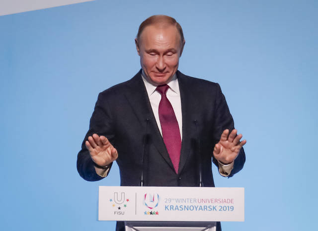 Russian President Vladimir Putin gestures while speaking during the opening ceremony for the 29th Winter Universiade games at the Platinum Arena in Krasnoyarsk, Russia, Saturday, March 2, 2019. (Maxim Shemetov/Pool Photo via AP)