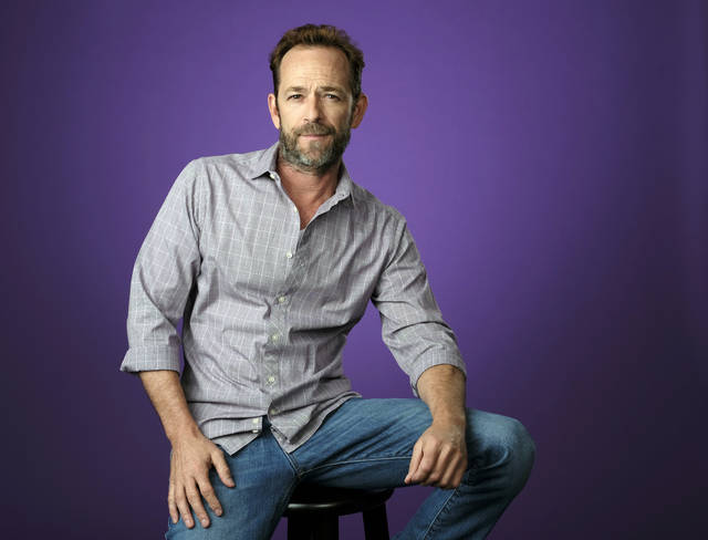 "FILE - In this Aug. 6, 2018, file photo, Luke Perry poses for a portrait during the 2018 Television Critics Association Summer Press Tour in Beverly Hills, Calif. A publicist for Perry says the ""Riverdale"" and ""Beverly Hills, 90210"" star has died. He was 52. Publicist Arnold Robinson said that Perry died Monday, March 4, 2019, after suffering a massive stroke. (Photo by Chris Pizzello/Invision/AP, File)"