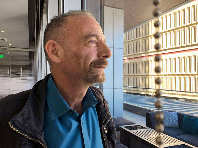 "Timothy Ray Brown poses for a photograph, Monday, March 4, 2019, in Seattle. Brown, also known as the ""Berlin patient,"" was the first person to be cured of HIV infection, more than a decade ago. Now researchers are reporting a second patient has lived 18 months after stopping HIV treatment without sign of the virus following a stem-cell transplant. But such transplants are dangerous, cannot be used widely and have failed in other patients. (AP Photo/Manuel Valdes)"