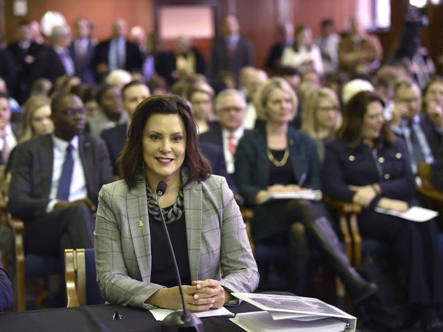 "Michigan Gov. Gretchen Whitmer presents her fiscal year 2020 budget proposal, called ""The Road To Opportunity,"" to lawmakers during a joint meeting of the House and Senate appropriations committees in the Senate Hearing Room in Lansing, Mich., Tuesday morning, March 5, 2019. (Todd McInturf/Detroit News via AP)"