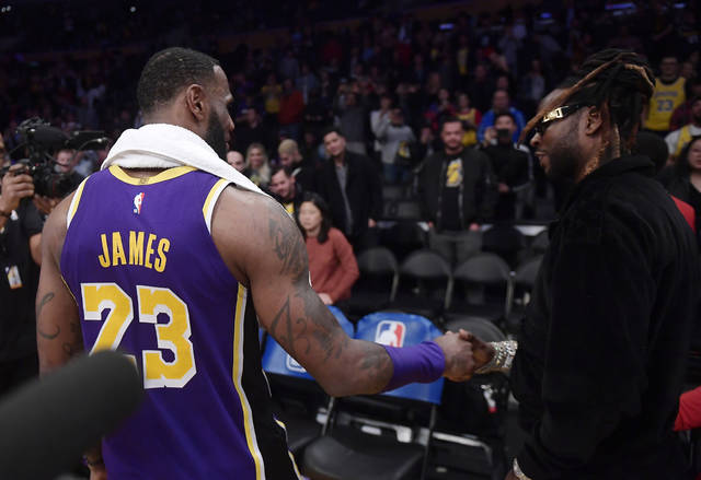 Los Angeles Lakers forward LeBron James, left, talks with rapper 2 Chainz after the Lakers' NBA basketball game against the Denver Nuggets on Wednesday, March 6, 2019, in Los Angeles. The Nuggets won 115-99. (AP Photo/Mark J. Terrill)
