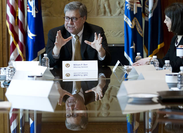 Attorney General William Barr speaks in a roundtable to address elder financial exploitation, at Department of Justice in Washington, Thursday, March 7, 2019. (AP Photo/Jose Luis Magana)