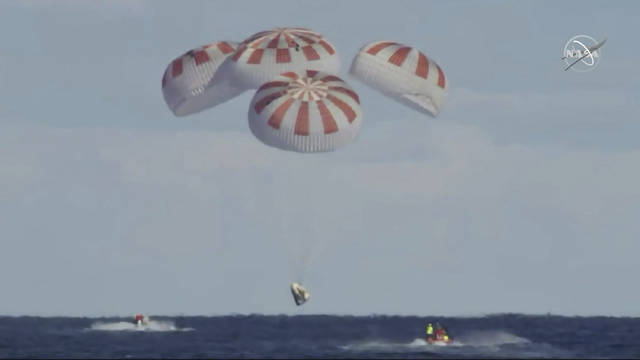 This image provided by NASA shows SpaceX's Dragon capsule carrying a test dummy splashed down into the Atlantic ocean off the Florida coast, Friday, March 8, 2019.  It marks the first time in 50 years that a capsule designed for astronauts returned from space by plopping into the Atlantic.  (NASA via AP)