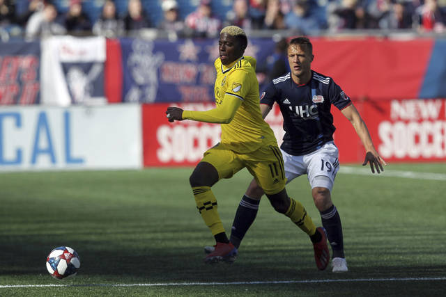 Columbus Crew's Gyasi Zardes (11) is defended by New England Revolution's Antonio Mlinar Delamea (19) during the first half of an MLS soccer game, Saturday, March 9, 2019, in Foxborough, Mass. (AP Photo/Stew Milne)