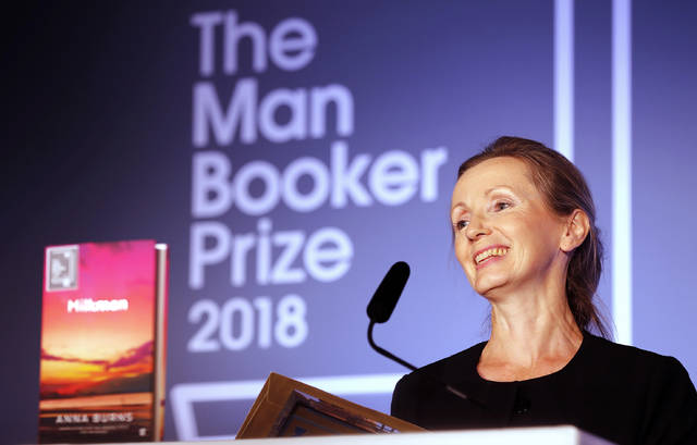 "FILE - In this Oct. 16, 2018 file photo, author Anna Burns smiles after being presented with the Man Booker Prize for Fiction 2018 for ""Milkman,"" during the prize's 50th year at the Guildhall in London. Burns' ""Milkman"" has been awarded the National Book Critics Circle prize for fiction.(AP Photo/Frank Augstein, File)"