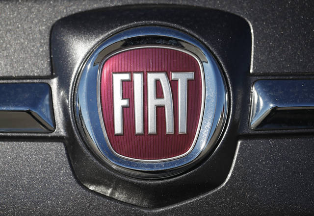 FILE- In this Oc. 21, 2018, file photo the company logo shines off the front of a vehicle at a Fiat dealership in Highlands Ranch, Colo. Fiat Chrysler is voluntarily recalling vehicles in the U.S. because they don't meet the country's emission standards. The Environmental Protection Agency says that the recall is the result of in-use emissions investigations it performed and in-use testing conducted by Fiat Chrysler as required by EPA regulations. (AP Photo/David Zalubowski, File)