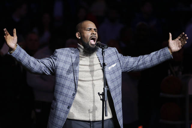 FILE - In this Nov. 17, 2015, file photo, musical artist R. Kelly performs the national anthem before an NBA basketball game between the Brooklyn Nets and the Atlanta Hawks in New York. Sex videos like those that have been integral to the criminal cases against R. Kelly have been circulating across the nation for years. Some of the tapes leaked out of the singer's collection in the 1990s. (AP Photo/Frank Franklin II, File)