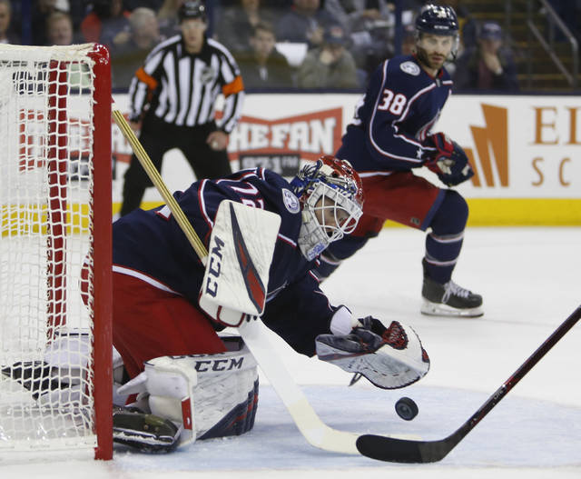 Columbus Blue Jackets' Sergei Bobrovsky, of Russia, makes a save against the Carolina Hurricanes during the first period of an NHL hockey game Friday, March 15, 2019, in Columbus, Ohio. (AP Photo/Jay LaPrete)