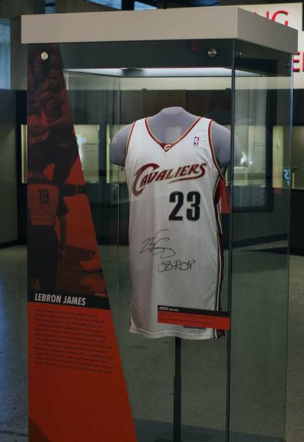 "In this March 11, 2019 photo, LeBron James's Rookie year basketball jersey is on display at the ""Ohio Champion of Sports"" exhibit at the Ohio History Connection in Columbus, Ohio. A new exhibit opening Saturday at the Ohio History Center will put a spotlight on Ohioans and their roles in shaping the nation's sports history. Ohio-Champion of Sports will remain open at least through September 2020.  (Brooke LaValley/The Columbus Dispatch via AP)"
