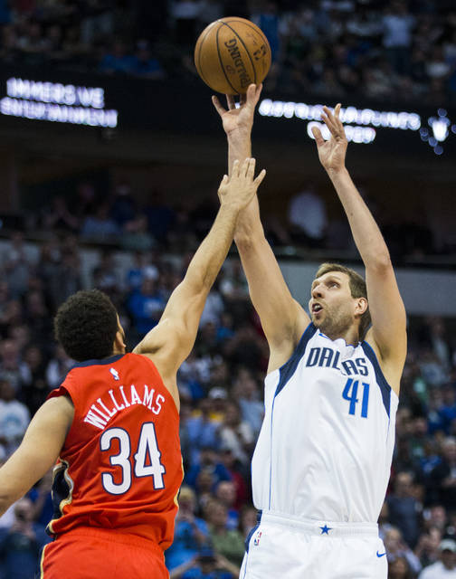 Dallas Mavericks forward Dirk Nowitzki (41) takes a shot during the first  half of an NBA basketball game against the New Orleans Pelicans in Dallas  on ... c47fe1a99