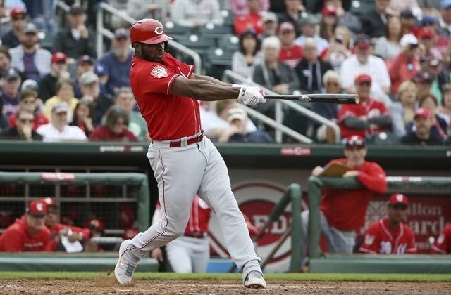 FILE - In this March 11, 2019, file photo, Cincinnati Reds' Yasiel Puig connects for a home run during the third inning of a spring training baseball game Monday,, in Goodyear, Ariz. Puig leads an infusion of players who hope to lead the last-place Reds back to respectability. (AP Photo/Ross D. Franklin, File)