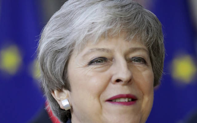 British Prime Minister Theresa May arrives for an EU summit in Brussels, Thursday, March 21, 2019. British Prime Minister Theresa May is trying to persuade European Union leaders to delay Brexit by up to three months, just eight days before Britain is scheduled to leave the bloc. (AP Photo/Olivier Matthys)
