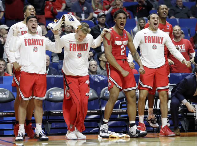Members of Ohio State cheer from the bench during the second half of a first round men's college basketball game against Iowa State in the NCAA Tournament Friday, March 22, 2019, in Tulsa, Okla. Ohio State won 62-59. (AP Photo/Jeff Roberson)