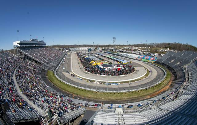 Fans enjoy the NASCAR Truck Series race at Martinsville Speedway in Martinsville, Va. Saturday, March 23. (AP Photo/Matt Bell)
