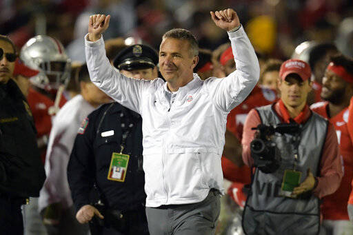 FILE - In this Tuesday, Jan. 1, 2019 file photo, Ohio State coach Urban Meyer celebrates at the end of the team's 28-23 win over Washington during the Rose Bowl NCAA college football game in Pasadena, Calif. Urban Meyer is headed back to television. Fox announced on Monday, March 11, 2019 that they have hired the former Ohio State coach as one of the analysts for its retooled college football pregame show. Fox also announced that it has hired Reggie Bush and will move Brady Quinn from the booth to the studio. (AP Photo/Mark J. Terrill, File)