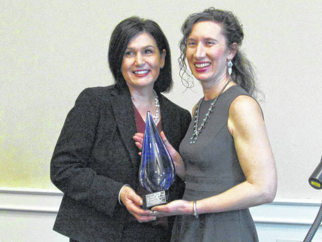 Bernadette Arehart (left) receiving the 2018 Ag Woman of the Year at the 2019 Central Ohio Farm Bureaus Women in Agriculture Brunch, March 2, at the Nationwide Hotel and Conference Center in Delaware County. Katherine Harrison (left), Ohio Farm Bureau state trustee for District 11, presented her with the award.