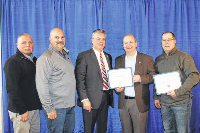 Pictured, left to right, are Mike Harter (DCAS Board member), Jon Melvin (DCAS Board member), Acting ODA Director Tim Derickson, Andrew Brenner (Fair Supporter Award winner) and Chip Thomson (DCAS Board member).
