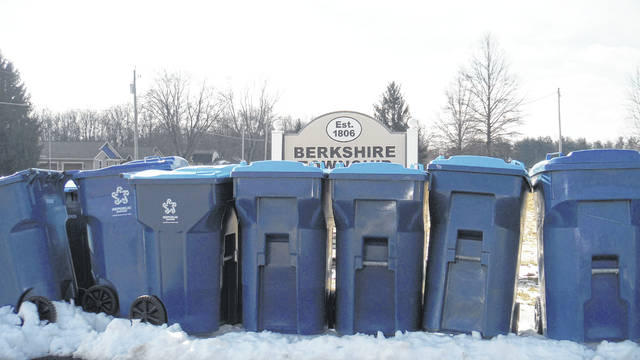 Trash cans from Republic Services are shown in front of the Township sign in a photo taken recently. Berkshire now uses Rumpke for trash hauling and recycling.