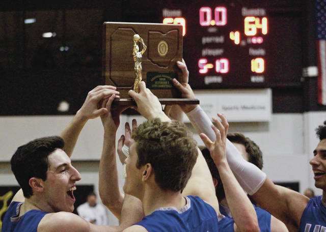 Members of the Olentangy Liberty boys basketball team hold up their championship trophy after beating Pickerington North 64-58 in Saturday's Division I regional final at Ohio Dominican.