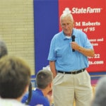 Legendary football coach speaks to Carroll players, fans