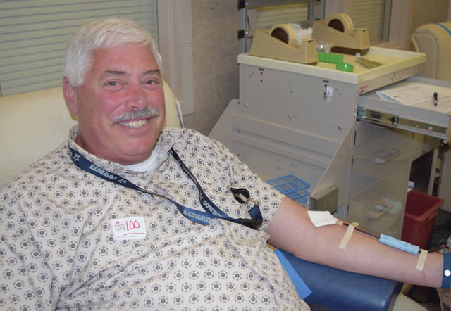 Submitted photo Beavercreek donor Bradley Paul crossed his milestone 100th lifetime blood donation at the Dayton Community Blood Center.