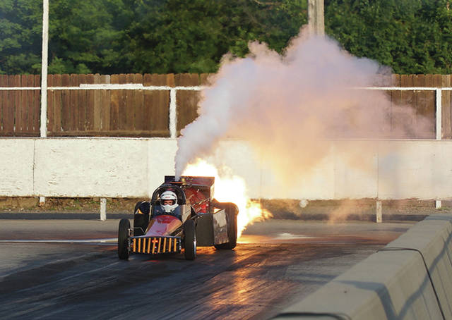 The Cannonball Express jet engine-powered dragster, driven by K.C. Jones of Van Nuys, Calif., lights up the starting area at Kil-Kare Dragway during Thursday's June 29 Night of Fire drag racing exhibition in Xenia.