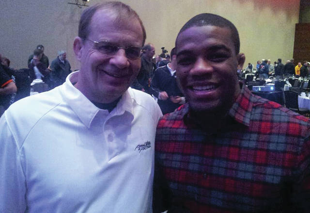 Submitted photos Beavercreek High School wrestling coach Gary Wise has received the Lifetime Service to Wrestling award and is being honored by the National Wrestling Hall of Fame in Oklahoma. Throughout his illustrious career, Wise has made many friends and contacts in the wrestling world. He is pictured with Olympic champion Jordan Burroughs.