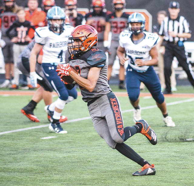 Beavercreek senior wing back Drew Nanda (9) takes a pitchout for a gain of 17 yards in the first half of Friday's Sept. 8 high school football game against Fairborn.