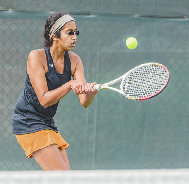 Beavercreek No. 2 singles player Dhira Venkatramani focuses on a backhand return during Wednesday's girls high school team tennis match with Bellbrook at the Five Seasons Sports Club in Centerville.