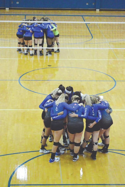 The Xenia and Greeneview girls high school volleyball teams huddle up before the start of their non-league match Sept. 13 in Jamestown.