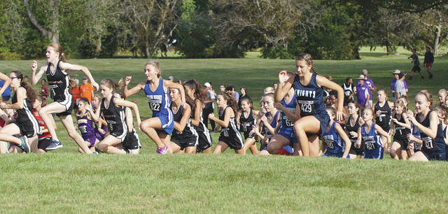 The runners in the Middle School girls cross country race head up the first hill of many at the 19th annual Ambassador Classic, Oct. 7 in Xenia.