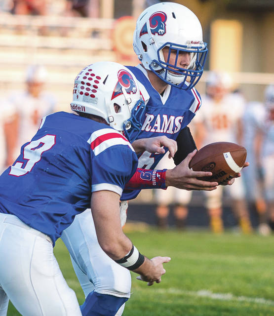 Greeneview junior quarterback Nick Clevenger (6) hands off to senior running back Griffin Mangan, during Friday's Sept. 22 high school football game against Ohio Heritage Conference foe Springfield Northeastern.