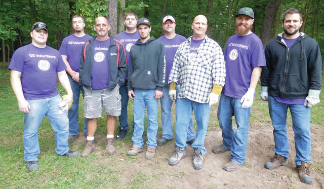 Submitted photo Unison employees recently spent a day volunteering at Russ Nature Reserve in Beavercreek.