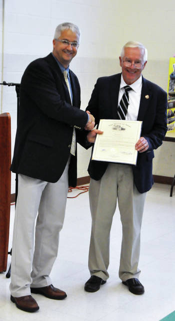 Greene County Career Center Superintendent Dave Deskins accepts a proclamation from Ohio State Representative Bill Dean for the work the school has done in providing workforce development programs for students.