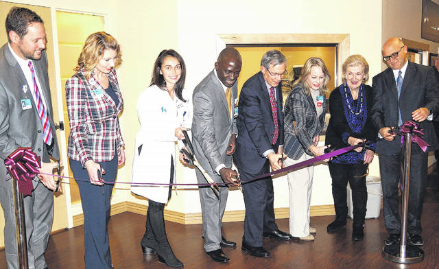 Barb Slone | News-Current Soin & Greene Memorial President/CEO Rick Dodds, Network Director for Cancer Care Elizabeth Garrison, Dr. Manisha Nanda, Dr. Zion Oshikanlu, Kettering Health Network President Roy Chew, Infusion Center director Terri VanZant-Marvin, Greene Medical Foundation Cheryl Lightle and Soin & GMH VP of Operations Ron Connovich.
