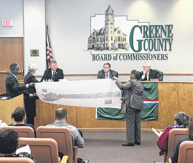 Anna Bolton | News-Current Greene County Commissioners Tom Koogler, Bob Glaser and Alan Anderson look at a map of the proposed areas for annexation.