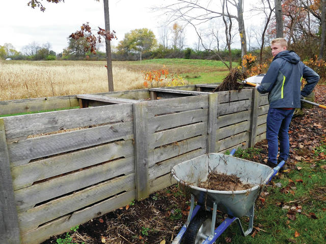 Submitted photos Joe Hammond transfers plant material to the compost bin system at Russ Nature Reserve.
