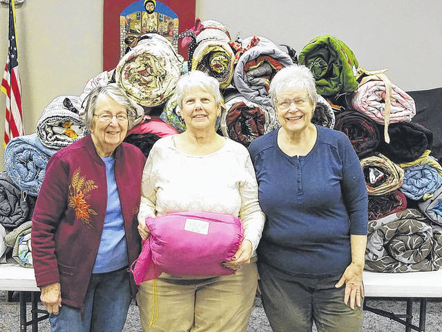 Submitted photo Pictured are Beverly Kunkle, Susie Demmy and Pam Sowder with their handy work - homemade sleeping bags.