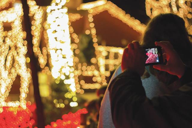 """Once the lights are lit – after dark – a light show occurs at regular intervals throughout the night, with lights """"dancing"""" to the tunes of popular Christmas songs."""