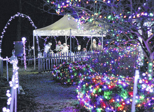 Naomi Harward   News-Current Greene County Parks and Trails is holding the annual Santa's Holiday in the Park at James Ranch Park on Fairground Road through Saturday, Dec. 9. Families line up outside the 1800s brick house to get pictures with Santa. Once inside, children are also given the opportunity to write letters to Santa and get removable Christmas tattoos. The lights at James Ranch Park.