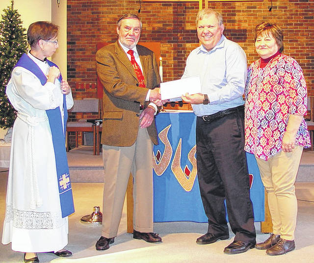 Submitted photo Pastor the Rev. Alicia Nierman and Bob Altick present a check to Bridges of Hope representatives Michael Deis and Marlene Labig.