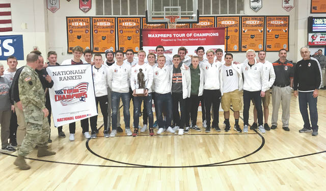 Submitted photo The Division I state champion Beavercreek High School boys varsity soccer team was presented with the Army National Guard national ranking trophy, Jan. 25 at the school. Beavercreek won its first state boys soccer title in school history on Nov. 11, 2017 with a 1-0 win over Medina at MAPFRE Stadium in Columbus. The Beavers were ranked as the No. 21 high school soccer team in the country by MaxPreps after finishing with a 23-0-2 season mark. MaxPreps rated more than 16,000 high school varsity soccer programs to determine the award recipients.