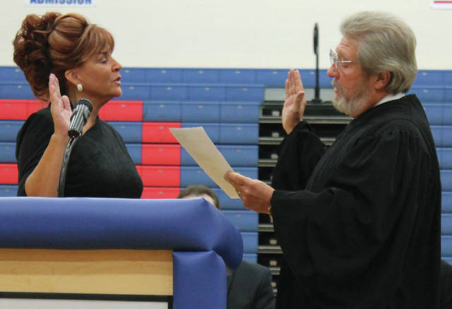 File photo Federal Court Judge Thomas Rose swears in Clerk of Courts Terri Mazur to her sixth term in December 2016 at Greeneview High School.