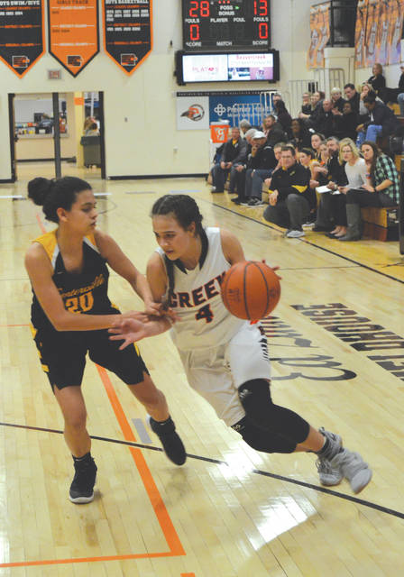 Beavercreek's Alyssa Hall (4) drives the baseline against Centerville's Amy Velasco, in Wednesday's Feb. 6 girls high school basketball game.