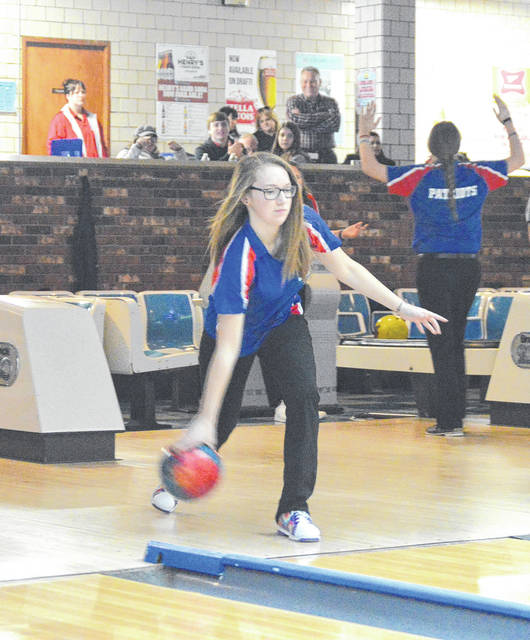 Carroll senior Abby Shahady delivers a strike, during warmups Jan. 30 at Poelking Lanes in Dayton.