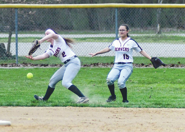 The slippery conditions made plays on the outfield pretty tough, as this Beavercreek play demonstrates, April 14 at Rotary Park in Beavercreek.